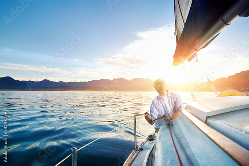 sunrise sailing boat