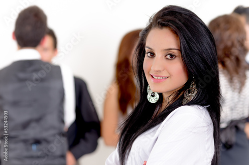 Portrait of businesswoman, team in background
