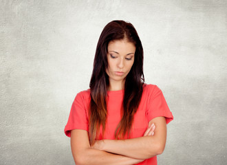 Depressed brunette girl dressed in red