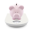 Piggy bank on scales