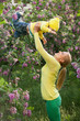 Happy young woman lifting her son high up
