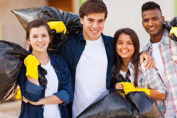 young volunteers with garbage bag