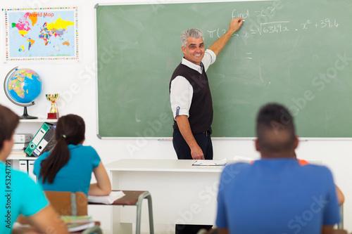 middle aged teacher teaching mathematics