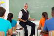male teacher explaining lesson to students