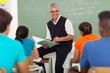 senior teacher teaching group of high school students