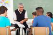 Leinwandbild Motiv senior high school teacher teaching in classroom