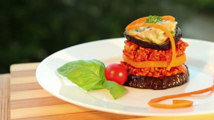 Moussaka - tofu cheese, eggplant, tomato - dolly shot