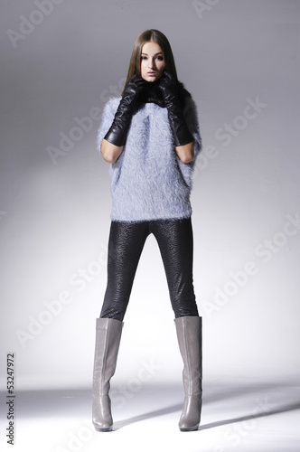 full body fashion woman in scarf with gloves posing