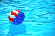 patriotic beach ball in pool - 53248571