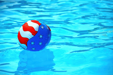 patriotic beach ball in pool