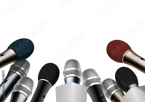 Press conference microphones over white