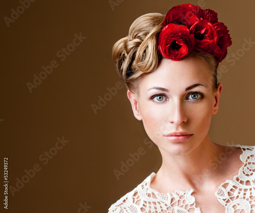 fashion model with hairstyle and flowers in her hair.