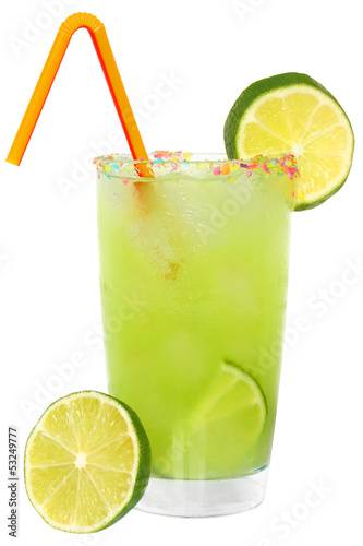 Fruit cocktail with lime and ice cubes in a glass decorated with