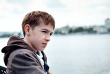 Portrait of teenager on background of river