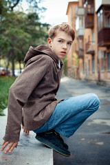 Portrait of teenager on background of city.