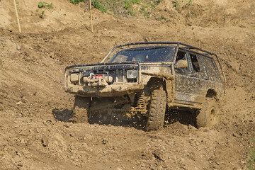 Off-road vehicle in muddy terrain.