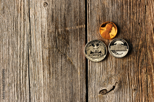 US cent coins over wooden background