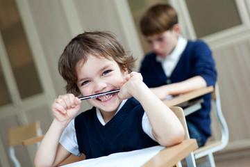 Diligent student sitting at desk, classroom