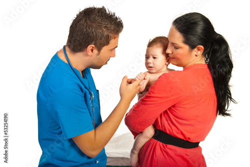 Mother with son visiting doctor