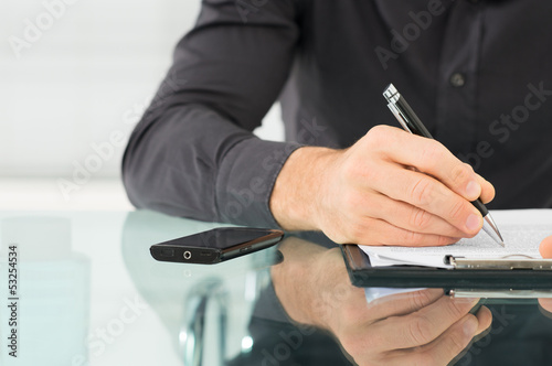 Businessman Writing a Paperwork