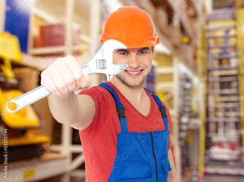 smiling worker with big spanner