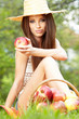 Apple woman. Very beautiful ethnic model eating red apple in the