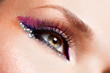Woman eyes with beautiful  fashion bright pink make-up