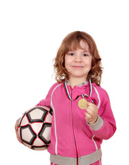 happy little girl with golden medal and soccer ball