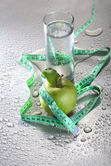 Healthy concept - apple glass of water and tape