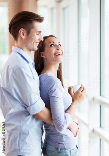 Couple hugging in new apartment
