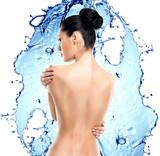 Beautiful female back over water splash
