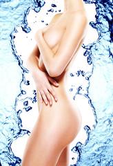 Beautiful female body over water splash