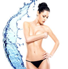 Beautiful sexy female body over water splash