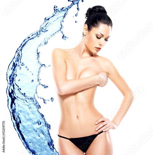 Beautiful sexy female body over water splash