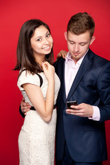 Woman and man looking at cellphone