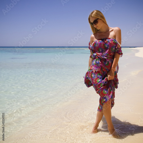 girl on the beach in the dress