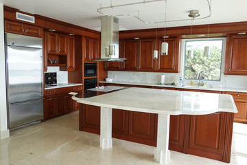 Modern, upscale kitchen with marble counter top