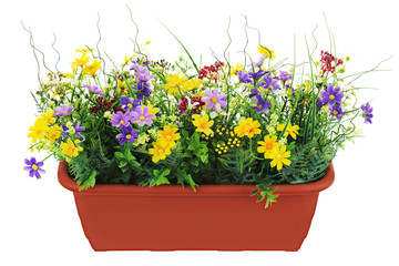 Composition of artificial garden flowers in brown flowerpot isol