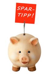 Freundliches lachendes Sparschwein und Notizzettel: Spartipp!