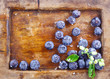 Close-up of blueberries in an old used wooden tray