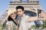 Couple take picture at Eiffel tower, Paris