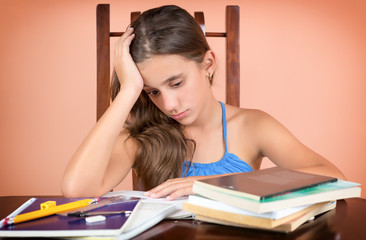 Hispanic student  exhausted after studying too much