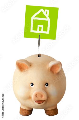 Freundliches Sparschwein und Notizzettel: Hausbau