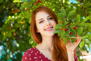 Redhead girl near cherry