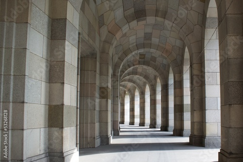 Fototapeta architectural background with a line of columns