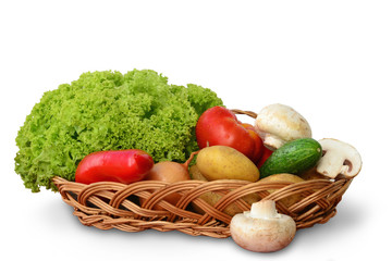 Vegetables in a basket on white