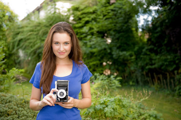 Young Girl Taking Photographs With Old Camera