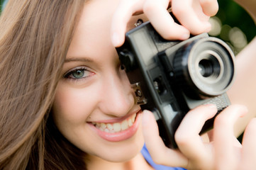 Young Woman With Camera Taking Photographs