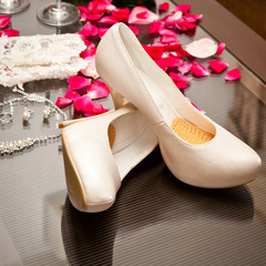 Accessories and shoes bride on the table