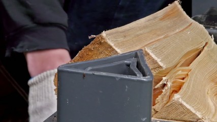 Crushing wood in a machine.